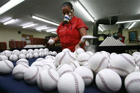 A worker selects baseballs for use at the 2010 Major League Baseball tournament at the Rawlings factory in Turrialba, Costa Rica